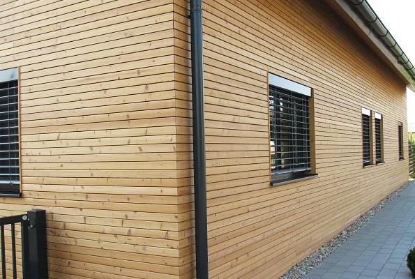 Отделка фасада частного дома планкеном